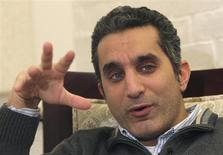 Popular Egyptian satirist Bassem Youssef gestures as he talks during an interview with Reuters in Cairo, January 15, 2013. REUTERS/Asmaa Waguih