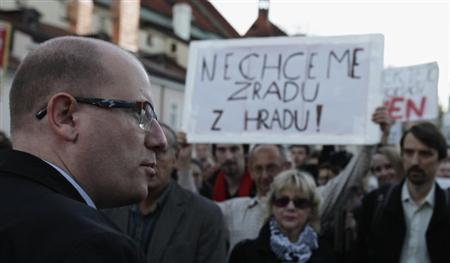 Czech Social Democratic Party (CSSD) leader Bohuslav Sobotka (L) arrives at a protest rally by his supporters in front of the Prague Castle in Prague October 28, 2013. REUTERS/David W Cerny