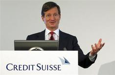 CEO Brady Dougan of Swiss bank Credit Suisse smiles as he addresses a news conference to present the bank's half-year results in Zurich July 25, 2013. REUTERS/Arnd Wiegmann