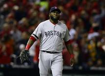 Boston Red Sox first baseman David Ortiz (34) reacts after the St. Louis Cardinals scored 2 runs during the seventh inning of game three of the MLB baseball World Series at Busch Stadium. Mandatory Credit: Jeff Curry-USA TODAY Sports