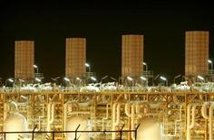 Facilities at phases 2-3 of the South Pars gas field, owned jointly by Iran and Qatar, are illuminated at night in Assaluyeh on Iran's Persian Gulf coast May 27, 2006. REUTERS/Morteza Nikoubazl