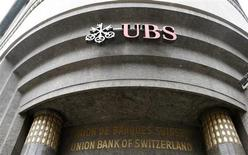 The logo of Swiss bank UBS is seen at a branch office in the north-eastern Swiss town of St. Gallen July 3, 2013. REUTERS/Arnd Wiegmann