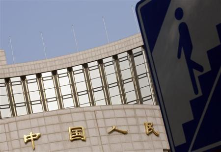 A sign showing the entrance to an underway passage is seen outside the headquarters of the People's Bank of China, the central bank, in Beijing October 17, 2013. REUTERS/Kim Kyung-Hoon