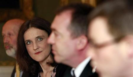 (L-R) Northern Ireland Justice Minister David Ford, Secretary of State for Northern Ireland Theresa Villiers , Police Service of Northern Ireland (PSNI) Chief Constable Matt Baggott and Assistant Chief Constable Alistair Finlay, co-host a news conference at Hillsborough Castle, in Northern Ireland May 9, 2013. REUTERS/Cathal McNaughton