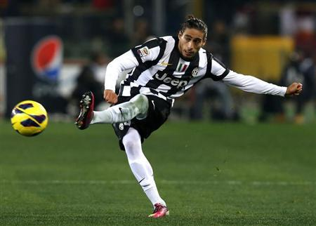 Juventus' Martin Caceres kicks the ball during his Italian Serie A soccer match against AS Roma at the Olympic stadium in Rome February 16, 2013. REUTERS/Alessandro Bianchi
