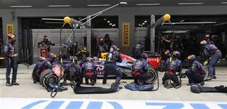 Red Bull Formula One driver Sebastian Vettel of Germany performs a pit stop during the Indian F1 Grand Prix at the Buddh International Circuit in Greater Noida, on the outskirts of New Delhi, October 27, 2013. REUTERS/Aijaz Rahi/Pool
