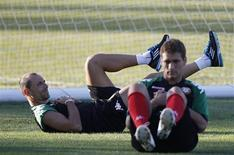 Bulgarian national soccer team players Martin Petrov (L) and Stiliyan Petrov attend a training session in the town of Pravets, some 40km (25 miles) northeast of Sofia August 29, 2011. REUTERS/Stoyan Nenov
