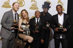 """Members of the Tedeschi Trucks Band Derek Trucks, Susan Tedeschi, Saunders Sermons, Kebbi Williams and Maurice Brown ( Lto R) celebrate backstage after winning Best Blues Album (""""Revelator"""") at the 54th annual Grammy Awards in Los Angeles, California February 12, 2012. REUTERS/Lucy Nicholson"""