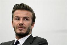 O ex-capitão da seleção inglesa, David Beckham, participa de entrevista coletiva em Shangai, China. Beckham, que se aposentou do futebol neste ano, escolheu Miami para uma nova equipe de expansão na liga norte-americana, a U.S. Major League Soccer, disse uma fonte familiarizada com as negociações nesta terça-feira. 20/06/2013. REUTERS/Aly Song