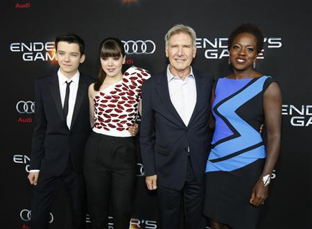 Cast members Asa Butterfield (L-R), Hailee Steinfeld, Harrison Ford and Viola Davis pose at the premiere of ''Ender's Game'' at the TCL Chinese theatre in Hollywood, California October 28, 2013. REUTERS/Mario Anzuon