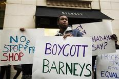 Demonstrators stand in front of a Barneys luxury department store of with signs decrying allegations that Barney's and Macy's stores have unfair security policies aimed at minorities in New York October 30, 2013. REUTERS/Lucas Jackson