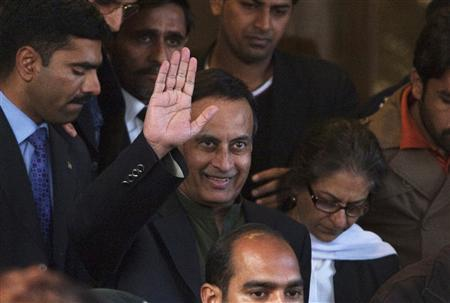 Former Pakistani ambassador to the United States Husain Haqqani waves to the media as he leaves the Supreme Court building after meeting his lawyer in Islamabad in this December 22, 2011 file photo. REUTERS/Faisal Mahmood/Files
