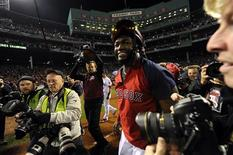 Oct 30, 2013; Boston, MA, USA; Boston Red Sox designated hitter David Ortiz celebrates on the field after game six of the MLB baseball World Series against the St. Louis Cardinals at Fenway Park. The Red Sox won 6-1 to win the series four games to two. Mandatory Credit: Robert Deutsch-USA TODAY Sports