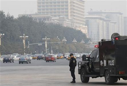 A policeman of the Special Weapons and Tactics (SWAT) team stands guard on a main street next to Tiananmen Square in Beijing October 31, 2013. Chinese state media demanded severe punishment on Thursday after the government blamed militants from restive Xinjiang for an attack in Tiananmen Square, as the exiled leader of the region's Uighur minority called for an independent probe. REUTERS/Kim Kyung-Hoon