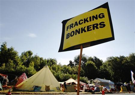 An anti-fracking sign is displayed at the protest camp by the entrance to a site run by Cuadrilla Resources, outside the village of Balcombe in southern England August 6, 2013. REUTERS/Luke MacGregor