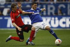 Bayer Leverkusen's Lars Bender tackles Schalke 04's Sead Kolasinac (R) during their German first division Bundesliga soccer match in Gelsenkirchen April 13, 2013. REUTERS/Ina Fassbender
