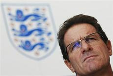 England soccer manager Fabio Capello speaks to the media at the Grove Hotel near Watford August 9, 2010. REUTERS/Luke MacGregor