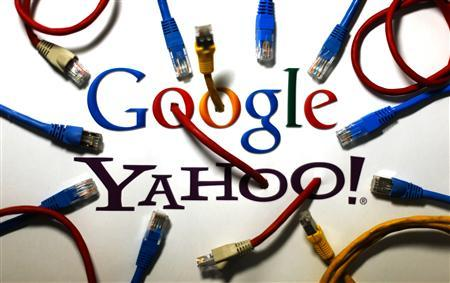 An illustration picture shows the logos of Google and Yahoo connected with LAN cables in a Berlin office October 31, 2013. REUTERS/Pawel Kopczynski
