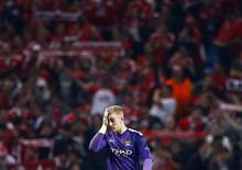Manchester City's Joe Hart reacts during their Champions League soccer match against Bayern Munich at the Etihad Stadium in Manchester, northern England, October 2, 2013. REUTERS/Darren Staples