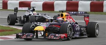 Red Bull Formula One driver Sebastian Vettel of Germany drives during the second practice session of the Canadian F1 Grand Prix at the Circuit Gilles Villeneuve in Montreal June 7, 2013. REUTERS/Christinne Muschi