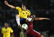 Colombia's Radamel Falcao Garcia (9) challenges Venezuela's Tomas Rincon during their 2014 World Cup qualifying soccer match in Puerto Ordaz March 26, 2013. REUTERS/Jorge Silva