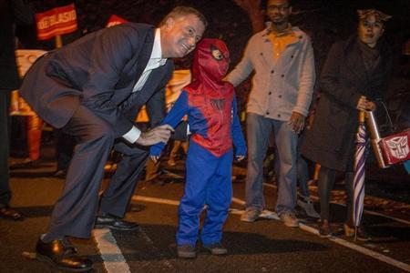 Democratic New York City mayoral candidate Bill de Blasio poses with a child dressed as Spiderman during the Park Slope Halloween Parade in the Brooklyn borough of New York, October 31, 2013. REUTERS/Brendan McDermid