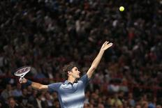 Roger Federer of Switzerland serves to Juan Martin Del Potro of Argentina in their quarterfinals match at the Paris Masters men's singles tennis tournament at the Palais Omnisports of Bercy in Paris, November 1, 2013. REUTERS/Charles Platiau