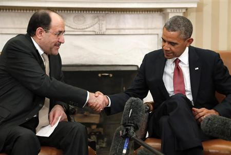 U.S. President Barack Obama (R) shakes hands with Iraq's Prime Minister Nuri al-Maliki (L) after their meeting in the Oval Office at the White House in Washington, November 1, 2013. REUTERS/Jonathan Ernst