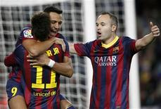 Barcelona's Alexis Sanchez (L, facing camera) celebrates a goal against Espanyol with teammates Neymar and Andres Iniesta (R) during their Spanish First division soccer league match at Camp Nou stadium in Barcelona, November 1, 2013. REUTERS/Albert Gea