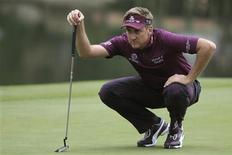 Ian Poulter of England looks over his putt on the 18th green during the third round of the WGC-HSBC Champions golf tournament in Shanghai November 2, 2013. REUTERS/Aly Song