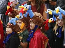"""Children wear promotional turkey hats at the world premiere of the animated film """"Free Birds"""" in Los Angeles, October 13, 2013. REUTERS/Danny Moloshok"""
