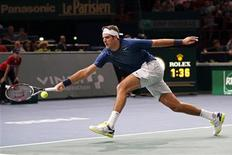 Juan Martin Del Potro of Argentina stretches to return to Marin Cilic of Croatia at the Paris Masters men's singles tennis tournament at the Palais Omnisports of Bercy in Paris, October 30, 2013. REUTERS/Charles Platiau