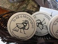 """Drink coasters are shown for sale in the gift shop of the Monroe County Heritage Museum in Monroeville, Alabama October 23, 2013. Harper Lee, the 87-year-old author of the still-popular 1960 bestseller, """"To Kill a Mockingbird"""", recently filed a lawsuit against the museum dedicated to her novel in a dispute over a merchandising trademark. Photo taken October 23, 2013. REUTERS/Verna Gates"""