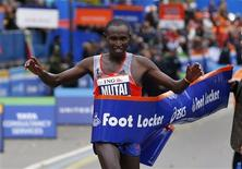 Geoffrey Mutai of Kenya crosses the finish line to win the men's division of the New York City Marathon in New York, November 3, 2013. REUTERS/Mike Segar