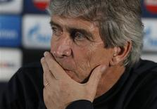 Manchester City's manager Manuel Pellegrini listens to questions during a news conference at the club's Carrington training complex in Manchester, northern England November 4, 2013. REUTERS/Phil Noble
