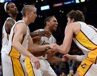 Nov 3, 2013; Los Angeles, CA, USA; Los Angeles Lakers shooting guard Xavier Henry (7) smiles as he helps up teammate Paul Gasol (16, right) after Gasol was fouled by the Atlanta Hawks Paul Milsap (not pictured) in the closing seconds at Staples Center. Robert Hanashiro-USA TODAY Sports