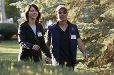 Amazon CEO Jeff Bezos (R) and his wife MacKenzie arrive at the annual Allen and Co. conference at the Sun Valley, Idaho Resort July 12, 2013. REUTERS/Rick Wilking