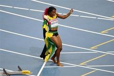 Shelly-Ann Fraser-Pryce of Jamaica celebrates winning the women's 100 metres final during the IAAF World Athletics Championships at the Luzhniki Stadium in Moscow August 12, 2013. REUTERS/Maxim Shemetov