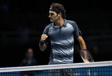 Roger Federer of Switzerland celebrates winning the second set of his men's singles tennis match against Novak Djokovic of Serbia at the ATP World Tour Finals at the O2 Arena in London November 5, 2013. REUTERS/Suzanne Plunkett