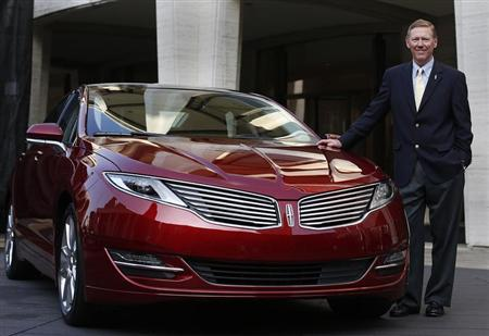 Alan Mulally, president and CEO of Ford Motor Company, stands next to the Lincoln MKZ mid-size sedan during a news conference in New York December 3, 2012. REUTERS/Shannon Stapleton
