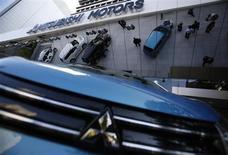 Mitsubishi Motors Corp's vehicles are seen at the company headquarters in Tokyo November 6, 2013. REUTERS/Issei Kato