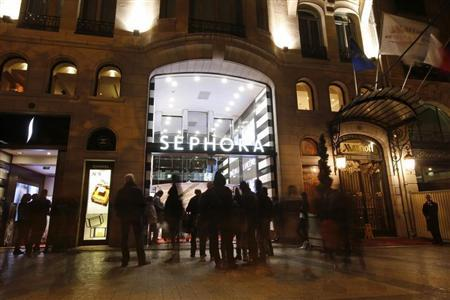 People walk out of the Sephora store on the Champs Elysees Avenue in Paris October 27, 2013. REUTERS/Benoit Tessier