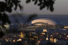A general view shows the Bolshoy Ice Dome during sunrise at the coastal cluster of 2014 Sochi Winter Olympics in Sochi October 25, 2013. Picture taken October 25, 2013. REUTERS/Thomas Peter
