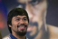 Boxer Manny Pacquiao of the Philippines smiles during a news conference in New York August 6, 2013. Pacquiao will fight Brandon Rios of the U.S. in a welterweight match at the Venetian Macao in Macau on November 24. REUTERS/Shannon Stapleton