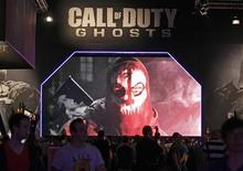 """Visitors look at a presentation of """"Call of Duty Ghosts"""" at an exhibition stand during the Gamescom 2013 fair in Cologne in this file photo taken August 21, 2013. REUTERS/Ina Fassbender/Files"""