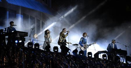 Indie rock band Arcade Fire performs at the Capitol Records building in Hollywood, California October 29, 2013. REUTERS/Gene Blevins