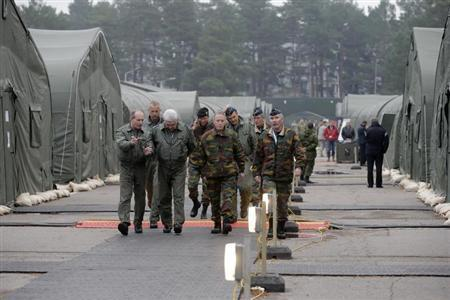 Military personnel walk in a military base during the ''Steadfast Jazz'' military exercise in Adazi November 6, 2013. REUTERS/Ints Kalnins