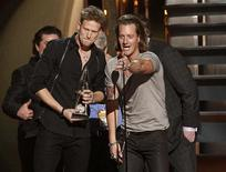 """Brian Kelley (L) and Tyler Hubbard (R) of Florida Georgia Line accept the award for single of the year for """"Cruise"""" at the 47th Country Music Association Awards in Nashville, Tennessee November 6, 2013. REUTERS/Harrison McClary"""