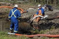 Emergency crews work to clean up an oil spill near Interstate 40 in Mayflower, Arkansas March 31, 2013. REUTERS/Jacob Slaton