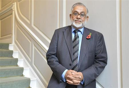 Britain-based Muslim leader Chowdhury Mueen Uddin poses for a portrait in London November 6, 2013. REUTERS/Toby Melville